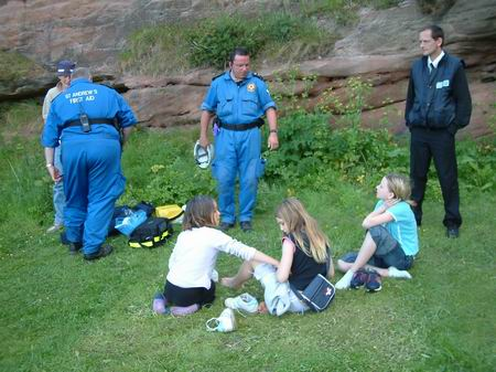 wemyss caves, children recieve first aid for some bites/scratches